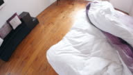 Point of view of man making bed up in the morning video