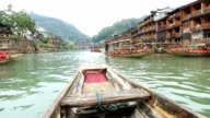Point of view of rowboat cruising on the river, China video