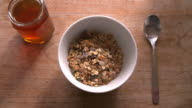 Point Of View Shot Of Pouring Muesli And Yogurt Into Bowl video