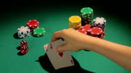 Poker player showing pair of aces, good chance to win video