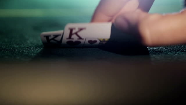 Poker player shows his pair hand two kings video