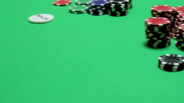 Poker players sitting at a green table video