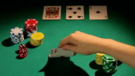 Poker professional checking cards, betting chips to raise bank, game video