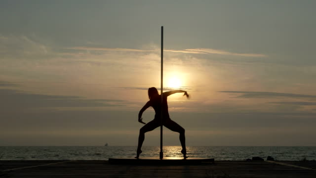 Pole dance fitness exercise on the beach video