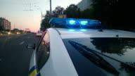 Police car LED strobe lightbar, flashing blue lights, emergency vehicle lighting video
