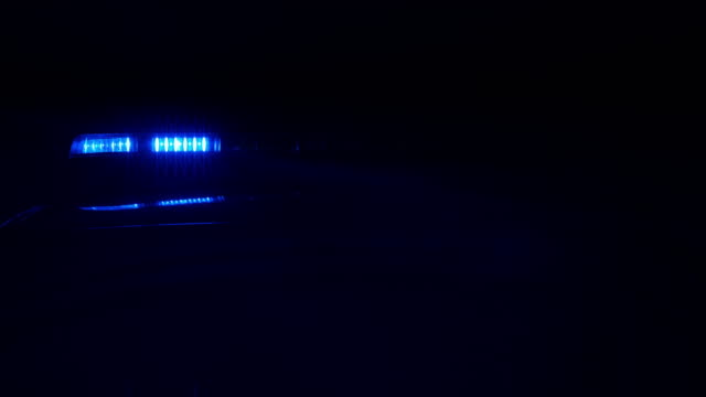 Police car lights, blue in total darkness video
