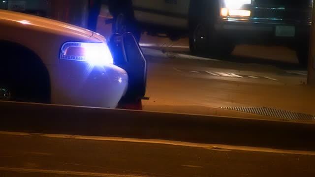 Police car with flashing strobe light on street video