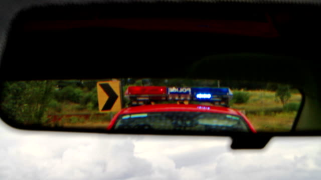 police emergency lights in the rearview mirror video