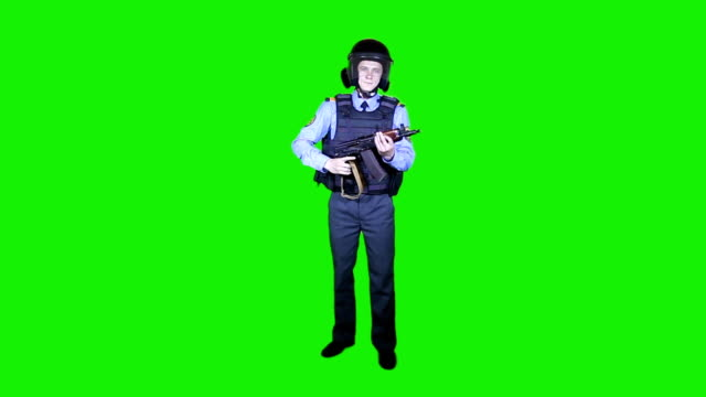 Police in helmets and body armor on a green background video