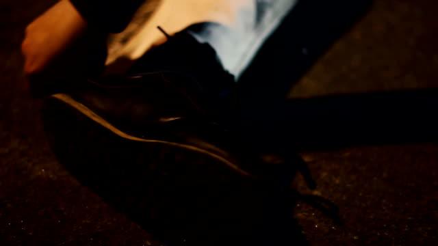 Police making chalk outline of dead body on crime scene, video
