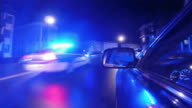 Police vehicle driving by with flashing lights video