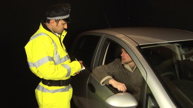 Policeman gives speeding ticket - HD & PAL video