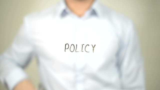 Policy , Man writing on transparent screen video