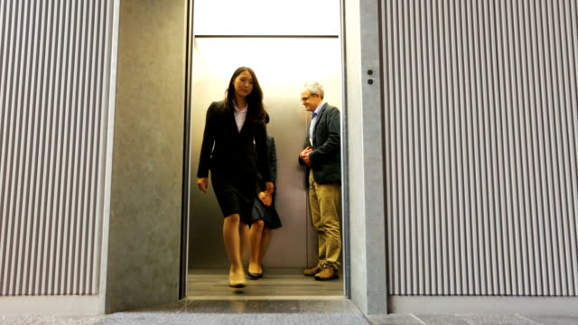 Polite Man Sharing Lift With Japanese Professional Business Women video