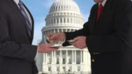 Politician giving bribe in front of US Capitol building video
