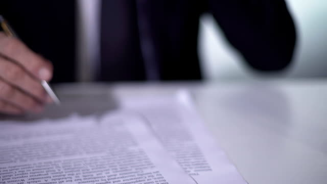 Politician reading and signing important reform document, sand flowing in clock video