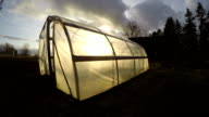 Polyethylene greenhouse in autumn, time lapse video