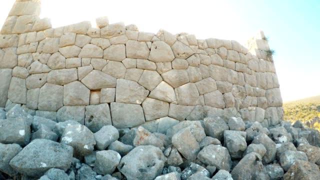 Polygonal laying of The most extant build among ruins close up Adamkayalar Mersin province Turkey Panorama video