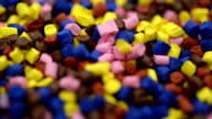 Polymer granules falling in slow motion video