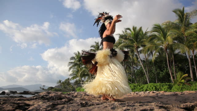 Polynesian dancer performs along rocky coastline video