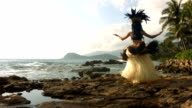 Polynesian dancer performs, slow motion video