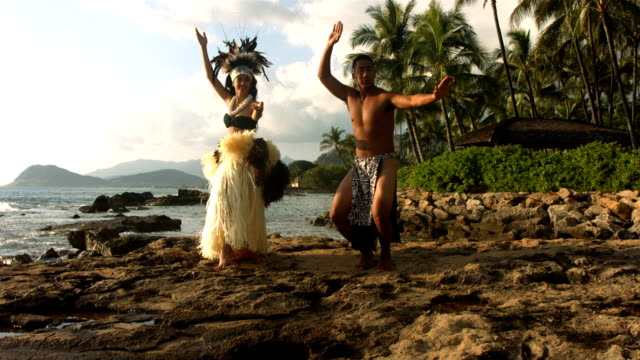Polynesian dancers perform by ocean video