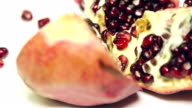 Pomegranate rotation on the table, close-up video