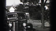1939: Pontiac 4 door sedan car backing out of driveway front hinged rear door technology. video