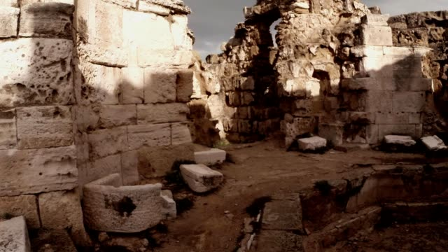 Pool and remaining of walls Roman baths ruins of antique town Salamis east Cyprus Famagusta video