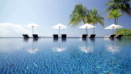 pool scenery with four parasols video