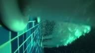 Pool water jet underwater jacuzzi spa, background loop. SLOW MOTION stock footage video