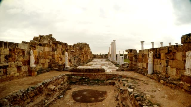 Pool with Antique white headless statues Roman Agora Cloudy day after rain ancient town Salamis video