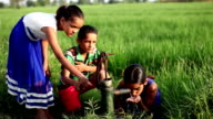 Poor Children drinking water outdoor in the nature video