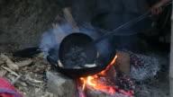 Poori (Indian Food) frying in cooking pan video