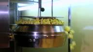 Popcorn maker in a movie theatre video