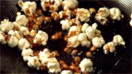 Popcorn popping in hot oil video