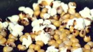 popping popcorn kernels video