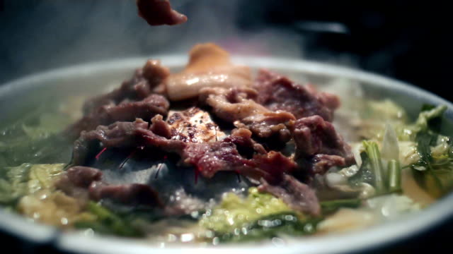 Pork Korean Barbecue on a hot pan with smoke, slow motion video