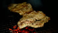 Pork steak on barbecue grill. video