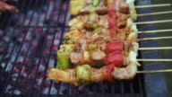 pork with vegetavble on skewers prepare for BBQ video