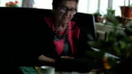 Porrtait of senior woman using electronic tablet video