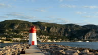Port entrance's lighthouse in Saint-Jean-Cap-Ferrat, French Riviera, France video