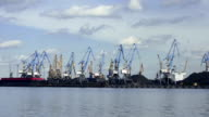 Port. Many Cranes transshipped coals of the Vessel. Time Lapse video