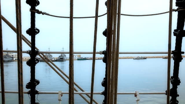 Port view through ship rigging video