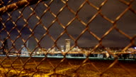 Portland, Oregon Cityscape Time Lapse from behind  Industrial Fence. video