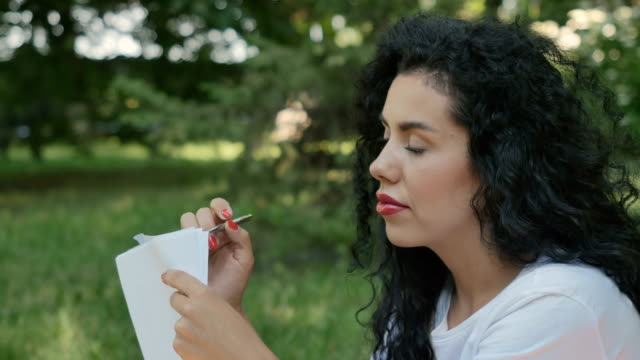 Portraif of pretty girl writing on paper video