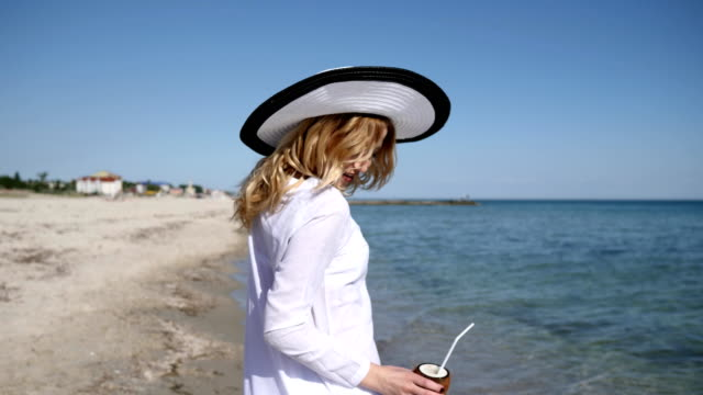 portrait beautiful female, in beach hat, in coast, expensive vacation video