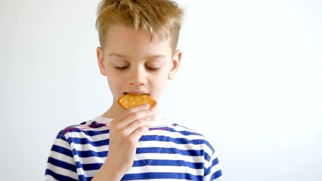 Portrait boy eating cookies, close-up video