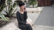 Portrait elegant businesswoman talking on the smartphone outdoor video
