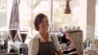 Portrait Female Employee In Coffee Shop Shot On R3D video